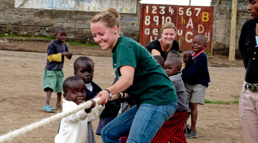 On a spring break alternative in Ghana, children play tug-of-war at the volunteer placement.